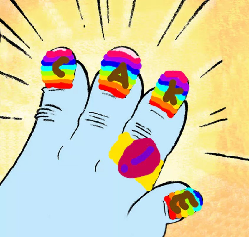 A yeti hand with rainbow painted nails that spell the word CAKE (also a ring with an exclamation mark on it)