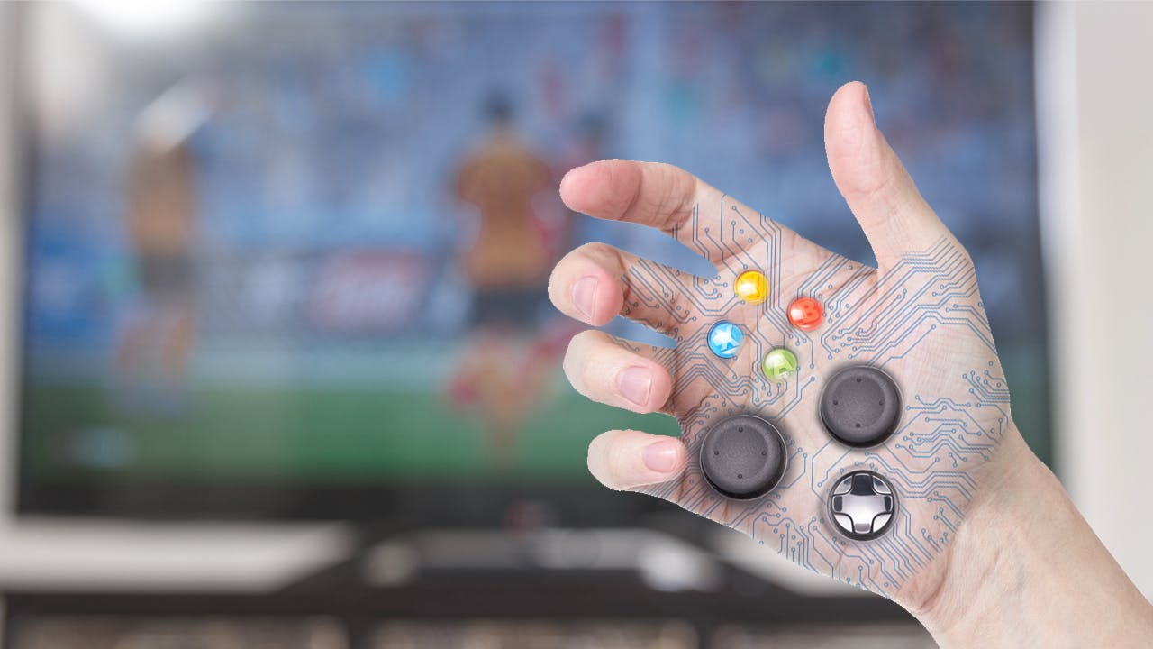 Game controller installed in a hand