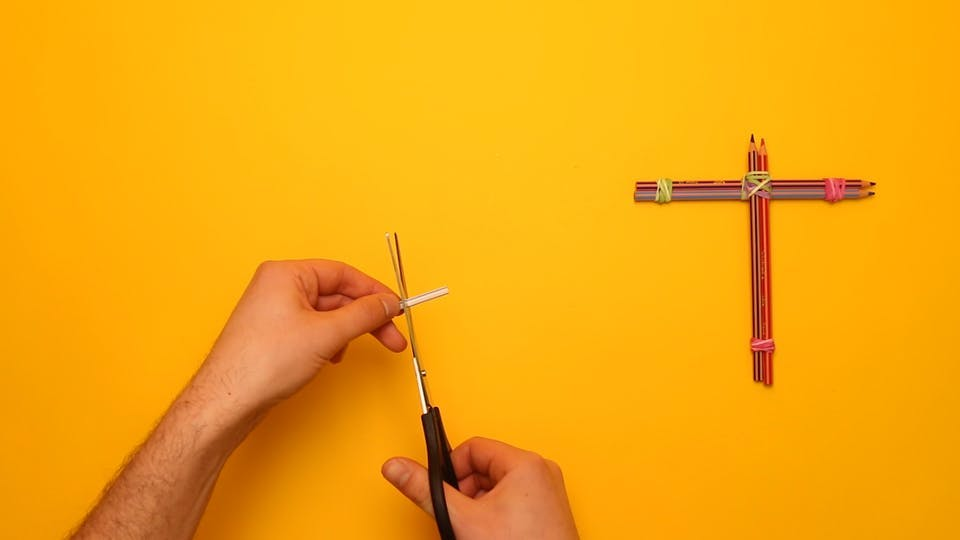 Cut a small piece of drinking straw off with scissors