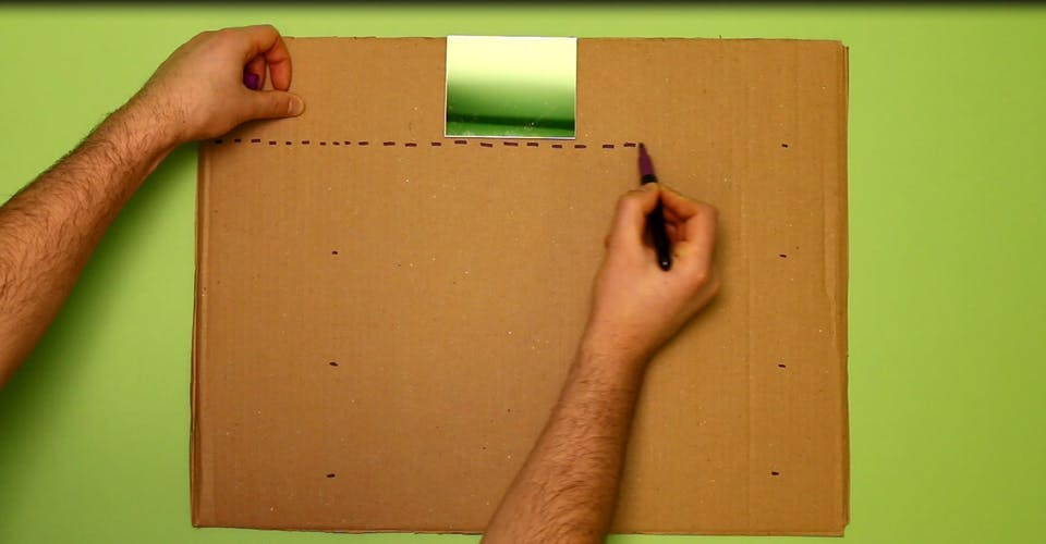 Draw out 4 lanes on your cardboard sheet