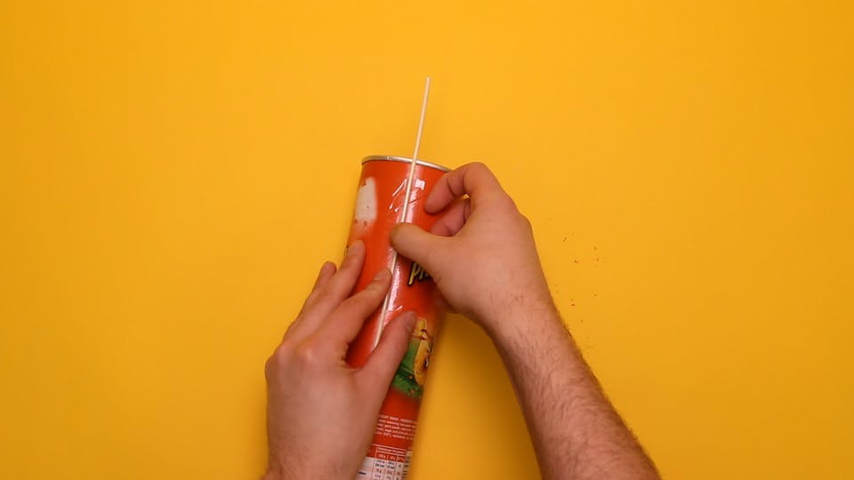 Tape a wooden skewer to the side of the tube