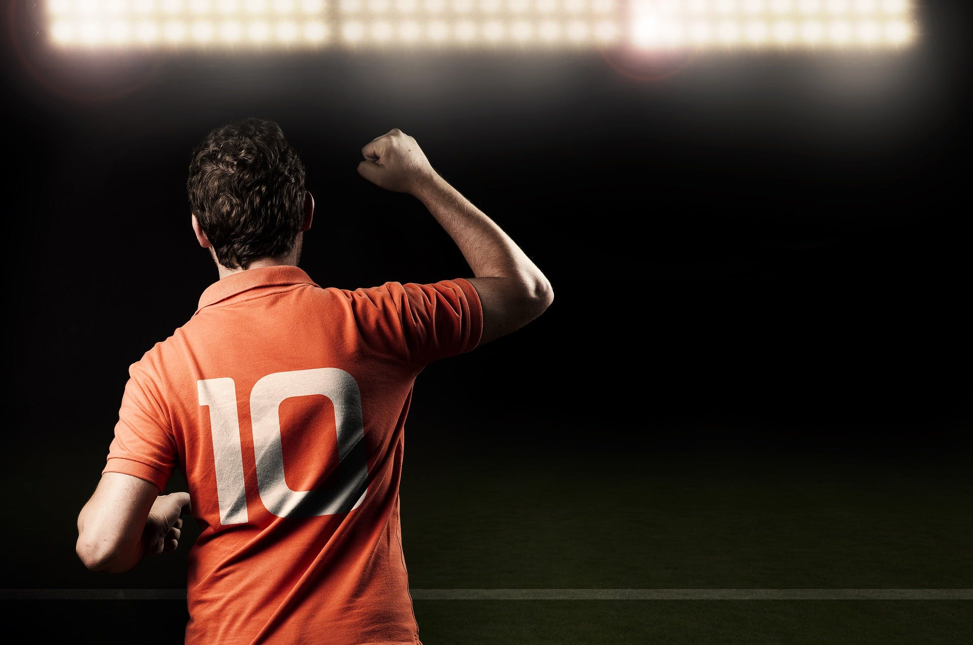 A footballer celebrates a goal