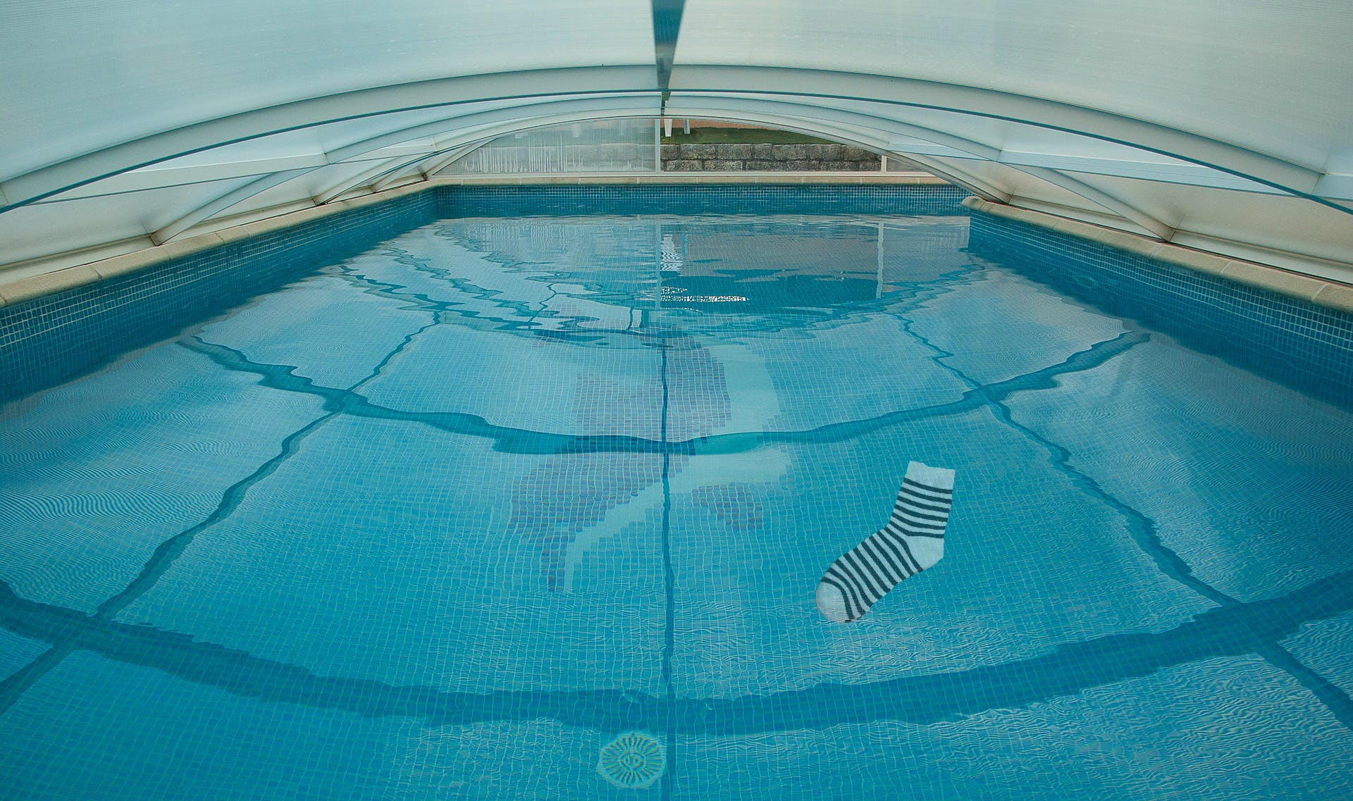 Here's a sock at the bottom of a swimming pool