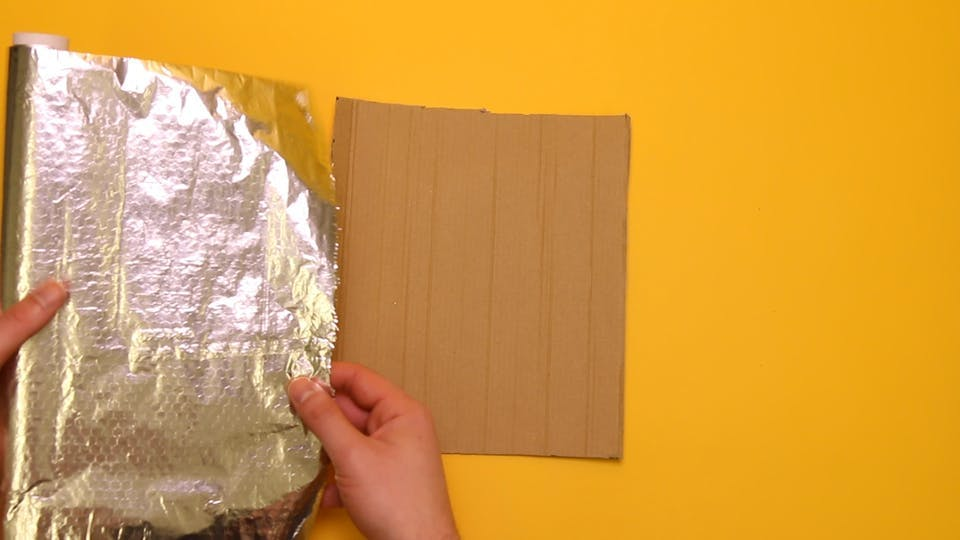 Cover the rectangle with foil using sticky tape to secure the edges