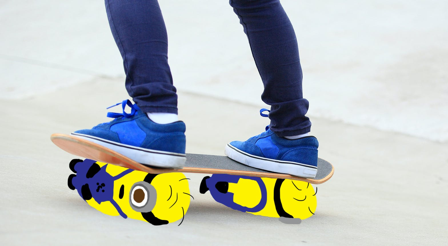 Two minions under a skateboard acting as wheels