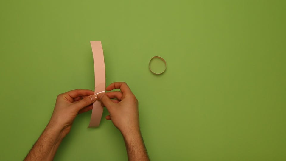 Tape the two strips and make another hoop