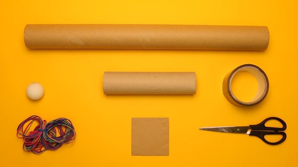You will need - a postal tube, cardboard tube, tape, scissors, cardboard, rubber bands, ammo