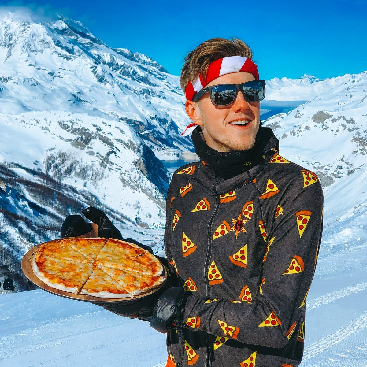 Lachlan in Val-d'Isère, France, holding a Pizza