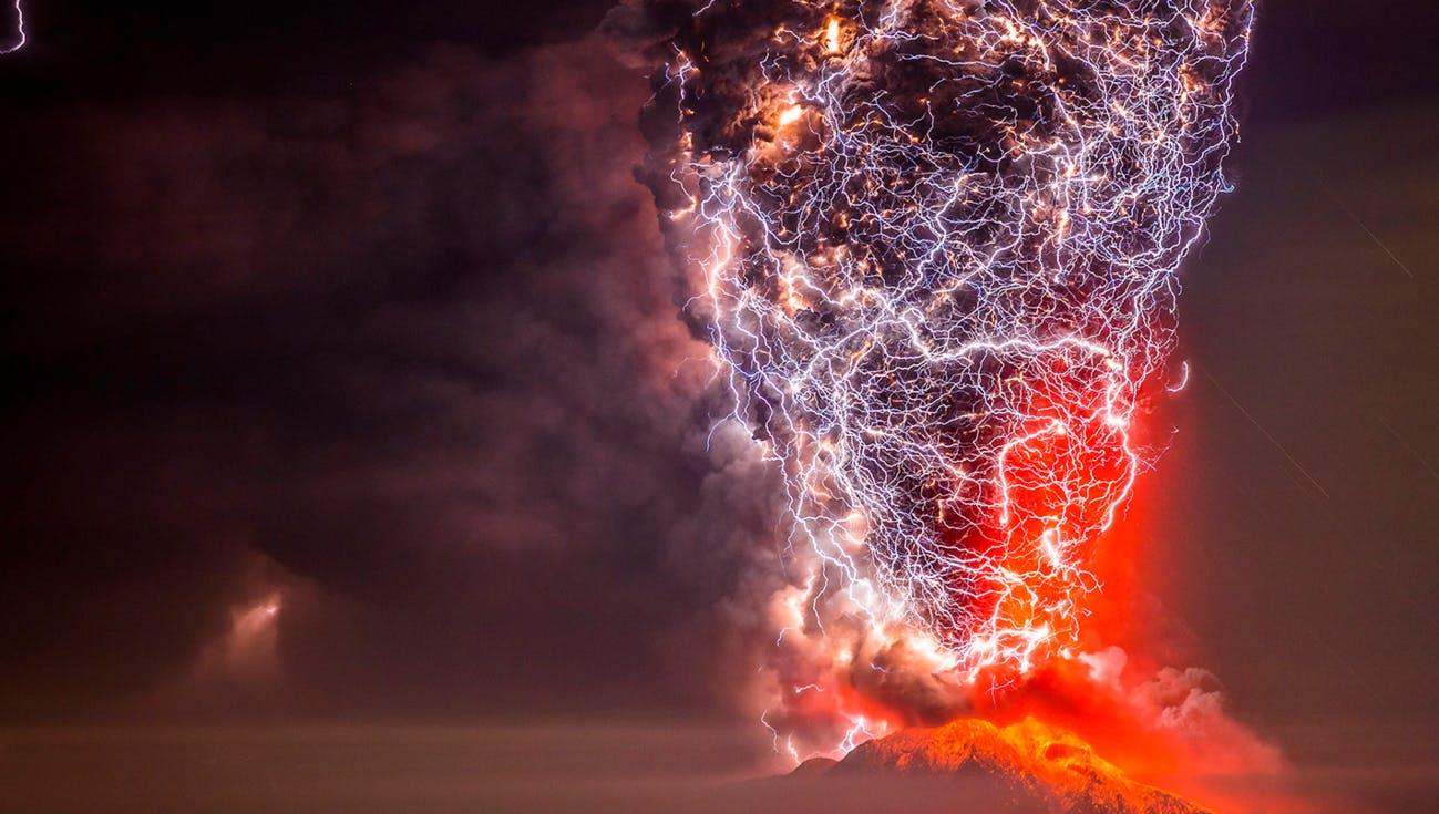 Volcano being struck by lightning