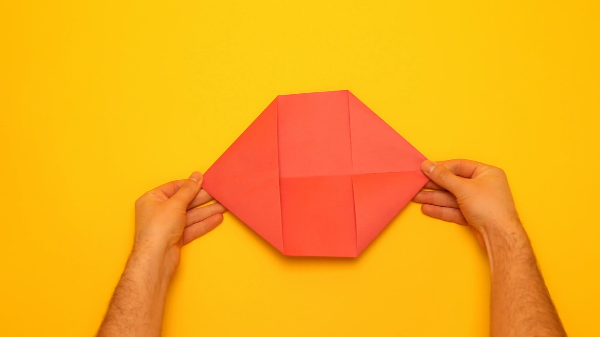 Fold each of the four corners into triangles