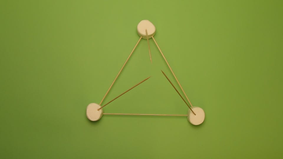 Add 3 more skewers diagonally to create a pyramid