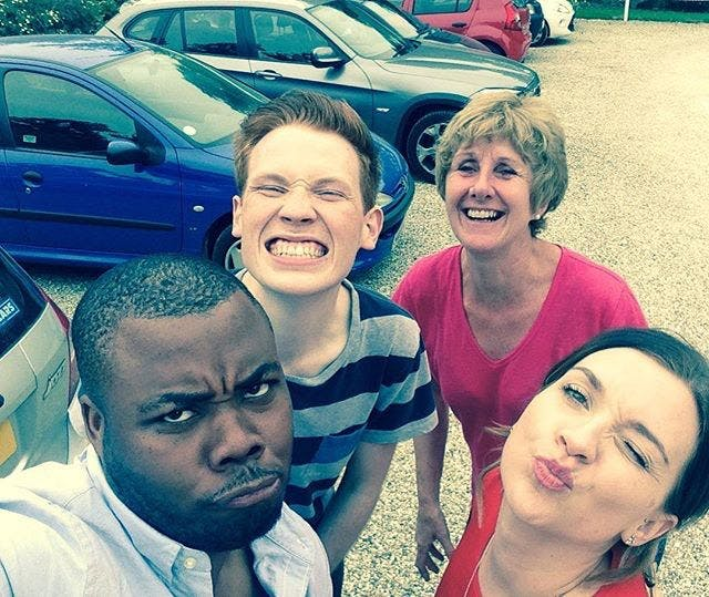 Selasi pulls a duck face during a Great British Bake Off photo