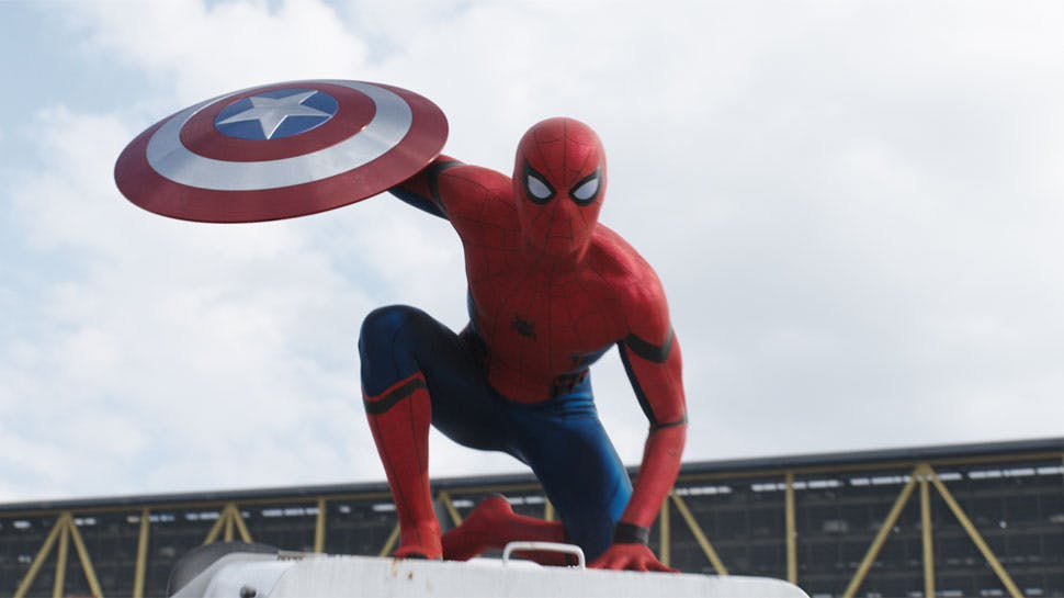 Spider-Man holds a shield with a star in the middle