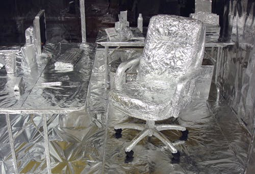 An office covered in foil