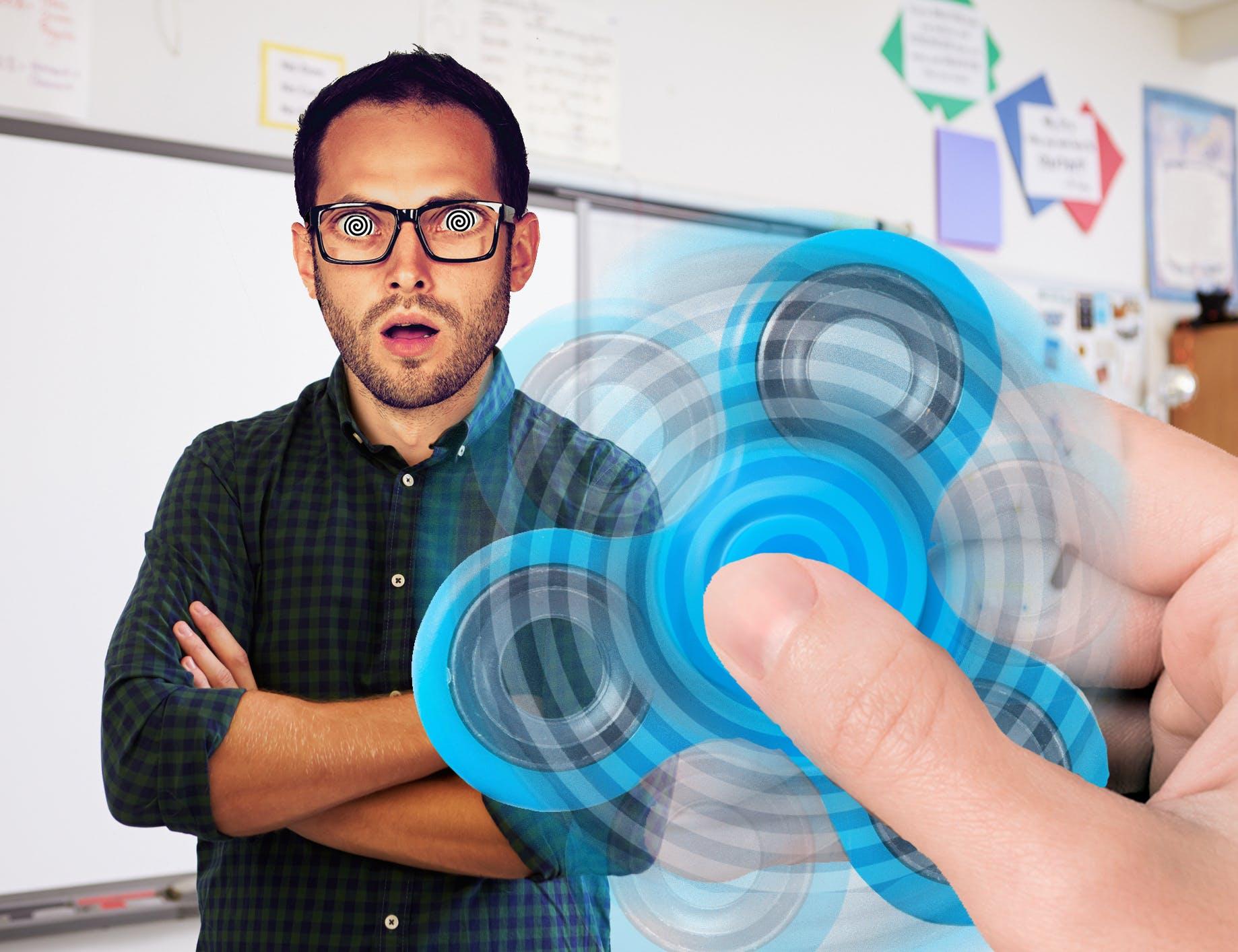 Teacher being hypnotised by a fidget spinner