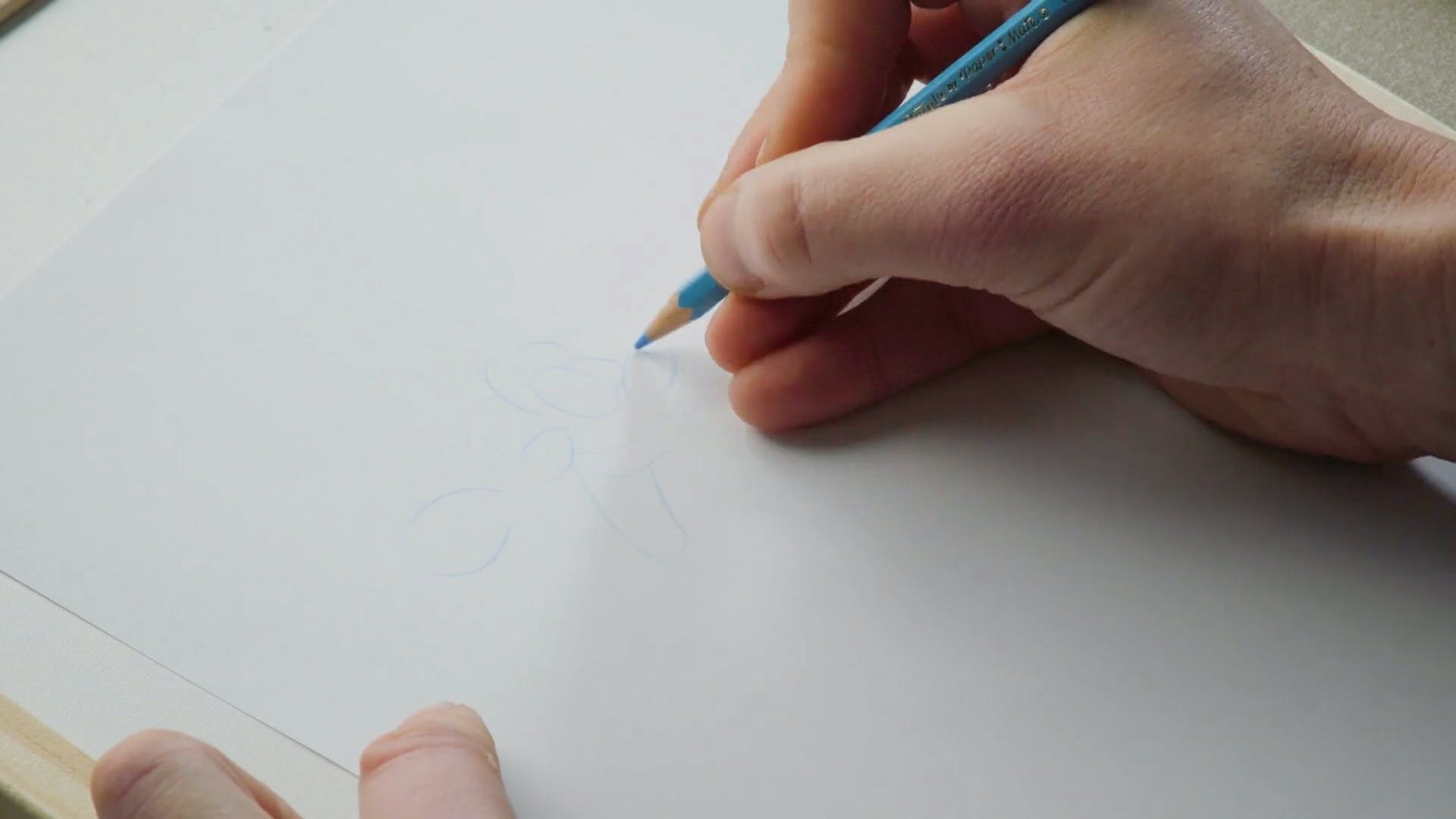 Chris McGhie drawing Ball Boy with a blue pencil
