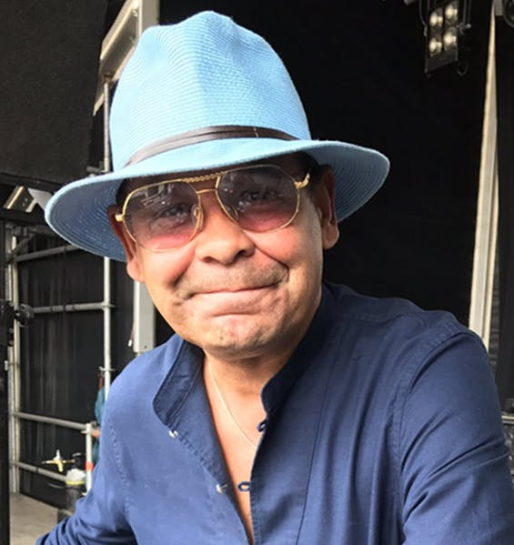 Craig Charles having a hat