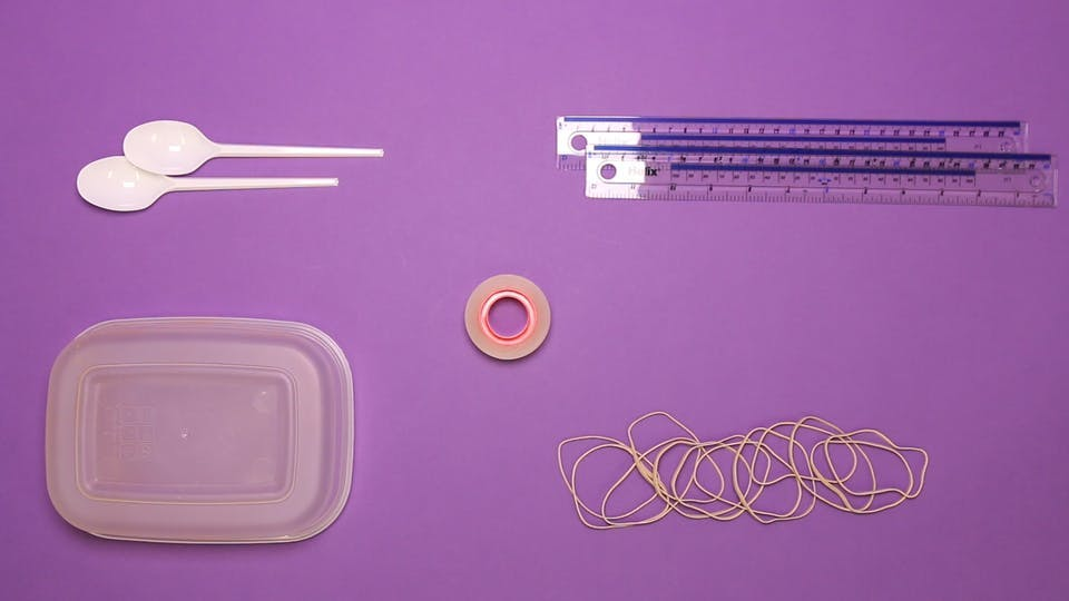 You will need - a plastic tub, 2 rulers, sticky tape, rubber bands, paper clips