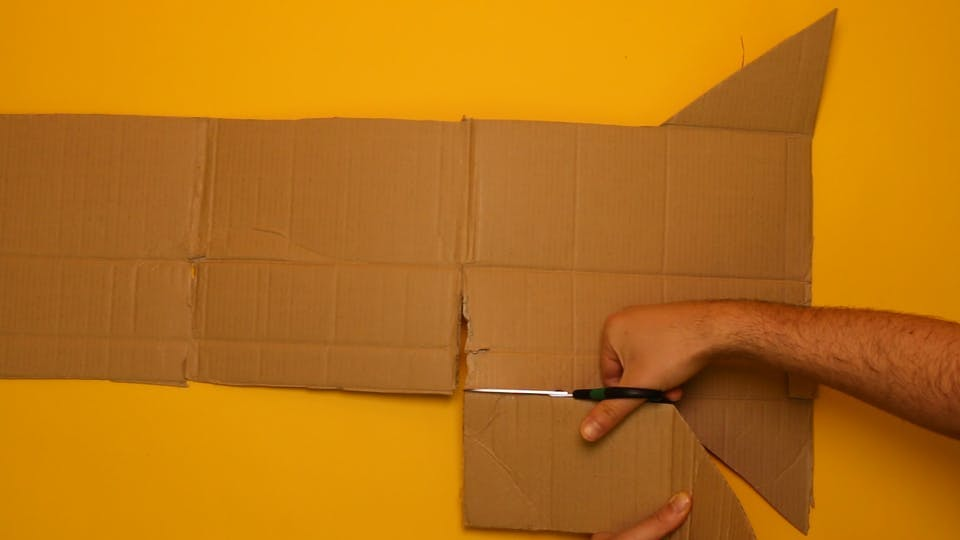 Cut off one end piece of the box, and the 4 flaps from the top and bottom of the box